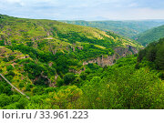 Khndzoresk cave city with a suspension bridge in the mountains of Armenia, a landmark of the country. Стоковое фото, фотограф Константин Лабунский / Фотобанк Лори