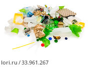 Pile of rubbish prepared for recycling isolated on white background. Стоковое фото, фотограф Константин Лабунский / Фотобанк Лори