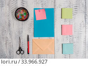 Envelope letter sticky note ballpoint clips can scissors wooden background. Стоковое фото, фотограф Zoonar.com/Artur Szczybylo / easy Fotostock / Фотобанк Лори