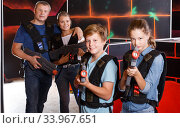 Glad boy and girl posing with laser guns. Стоковое фото, фотограф Яков Филимонов / Фотобанк Лори