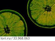Купить «Two half juicy ripe orange isolated on white background», фото № 33968063, снято 26 января 2019 г. (c) Nataliia Zhekova / Фотобанк Лори