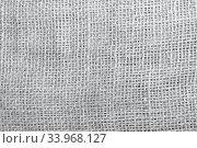 Купить «The texture of coarse burlap closeup», фото № 33968127, снято 8 октября 2016 г. (c) Nataliia Zhekova / Фотобанк Лори