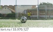African American soccer kid in blue scoring in a sunny day. Стоковое видео, агентство Wavebreak Media / Фотобанк Лори