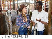 Купить «Farm workers talking emotionally at stable», фото № 33976423, снято 2 октября 2018 г. (c) Яков Филимонов / Фотобанк Лори