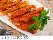 Купить «Image of slices of smoked salmon belly at plate», фото № 33976535, снято 11 июля 2020 г. (c) Яков Филимонов / Фотобанк Лори