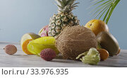 Купить «Panoramic video around composition of fresh natural ripe exotic fruits on a woodwn gray table on a blue background. Motion, 4K UHD video, 3840, 2160p.», видеоролик № 33976935, снято 12 июля 2020 г. (c) Ярослав Данильченко / Фотобанк Лори