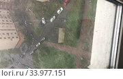 View at the hailstorm from window of building. Vertical video. Стоковое видео, видеограф Кекяляйнен Андрей / Фотобанк Лори