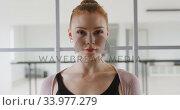 Купить «Caucasian female ballet dancer standing a bright studio and looking at camera», видеоролик № 33977279, снято 24 октября 2019 г. (c) Wavebreak Media / Фотобанк Лори