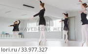 Купить «Caucasian female ballet dancers practicing a dance routine during a ballet class», видеоролик № 33977327, снято 24 октября 2019 г. (c) Wavebreak Media / Фотобанк Лори