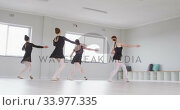 Купить «Caucasian female ballet dancers practicing a dance routine during a ballet class», видеоролик № 33977335, снято 24 октября 2019 г. (c) Wavebreak Media / Фотобанк Лори