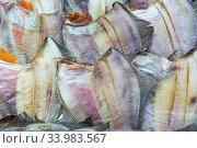 Купить «Lot of salted dried fish ocean plaice. Background of group flatfish with caviar. Close-up flat lay view of prepared and ready-to-eat Pacific seafood», фото № 33983567, снято 11 июня 2020 г. (c) А. А. Пирагис / Фотобанк Лори