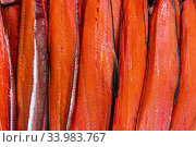 Купить «Close up view of lot fillet salted cold smoked red fish King Salmon. Prepared and ready-to-eat Pacific fish Chinook Salmon - Asian delicacy cuisine», фото № 33983767, снято 11 июня 2020 г. (c) А. А. Пирагис / Фотобанк Лори