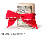 Купить «Vertical Roll Of One Hundred Dollar Bills Tied With Red Ribbon Isolated On White Background», фото № 33989647, снято 11 июля 2020 г. (c) easy Fotostock / Фотобанк Лори