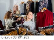 Купить «Women shopping in clothing boutique», фото № 33991935, снято 6 декабря 2018 г. (c) Яков Филимонов / Фотобанк Лори