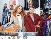 Women posing in overcoats in clothing boutique. Стоковое фото, фотограф Яков Филимонов / Фотобанк Лори