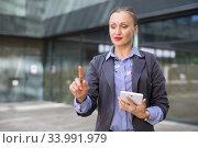 Купить «Employee woman with tablet touching finger on air», фото № 33991979, снято 6 мая 2017 г. (c) Яков Филимонов / Фотобанк Лори