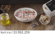 Купить «Woman's hand is making photos of freshly cooked healthy breakfas», видеоролик № 33992259, снято 3 июля 2020 г. (c) Ярослав Данильченко / Фотобанк Лори