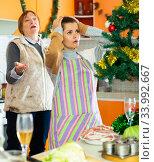Women quarreling at kitchen. Стоковое фото, фотограф Яков Филимонов / Фотобанк Лори