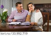 Купить «Couple looking worriedly at papers», фото № 33992719, снято 8 декабря 2019 г. (c) Яков Филимонов / Фотобанк Лори