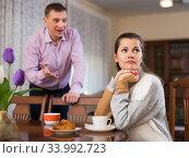 Frustrated woman while man rebuking her. Стоковое фото, фотограф Яков Филимонов / Фотобанк Лори