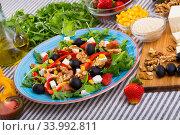 Купить «Rocket salad with ingredients», фото № 33992811, снято 22 июня 2018 г. (c) Яков Филимонов / Фотобанк Лори