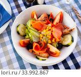 Купить «Salad with smoked salmon, prawns, vegetables and corn», фото № 33992867, снято 11 июля 2020 г. (c) Яков Филимонов / Фотобанк Лори