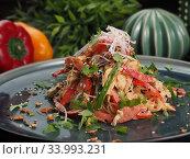 Купить «Asian rice noodles salad with chicken meat, tomatoes, sesame, radishes, nuts and greens», фото № 33993231, снято 2 мая 2019 г. (c) Алексей Кокорин / Фотобанк Лори