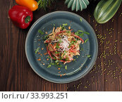 Купить «Asian rice noodles salad with chicken meat, tomatoes, sesame, radishes, nuts and greens», фото № 33993251, снято 2 мая 2019 г. (c) Алексей Кокорин / Фотобанк Лори