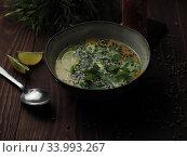 Tom Kha Gai coconut milk soup with chicken. Стоковое фото, фотограф Алексей Кокорин / Фотобанк Лори