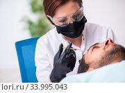 Купить «Young man visiting female beautician in hair transplantation con», фото № 33995043, снято 1 октября 2019 г. (c) Elnur / Фотобанк Лори