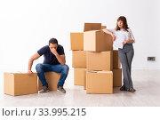 Купить «Young pair and many boxes in divorce settlement concept», фото № 33995215, снято 3 сентября 2019 г. (c) Elnur / Фотобанк Лори