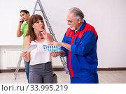 Купить «Young couple and old contractor in home renovation concept», фото № 33995219, снято 2 сентября 2019 г. (c) Elnur / Фотобанк Лори