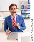 Купить «Funny bisinessman with fake moustache in the office», фото № 33995551, снято 20 августа 2018 г. (c) Elnur / Фотобанк Лори