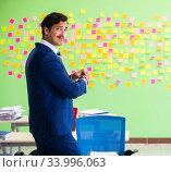 Купить «Businessman with many conflicting priorities», фото № 33996063, снято 23 мая 2018 г. (c) Elnur / Фотобанк Лори