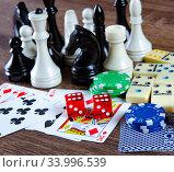 Купить «Chess and other gaming accessories», фото № 33996539, снято 18 октября 2017 г. (c) Elnur / Фотобанк Лори