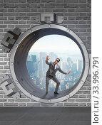 Blindfolded businessman in front ot vault door. Стоковое фото, фотограф Elnur / Фотобанк Лори