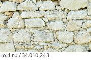 Купить «Old weathered stone wall for background. Close-up.», фото № 34010243, снято 10 июля 2020 г. (c) age Fotostock / Фотобанк Лори
