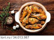 Купить «Roasted chicken legs on rustic wooden background, top view», фото № 34013987, снято 10 июля 2020 г. (c) easy Fotostock / Фотобанк Лори