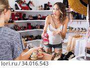 Dissapointed woman choosing shoes. Стоковое фото, фотограф Яков Филимонов / Фотобанк Лори