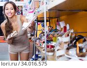Купить «young woman in shoes store», фото № 34016575, снято 9 июля 2020 г. (c) Яков Филимонов / Фотобанк Лори