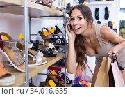 Woman talking on mobile phone in boutique. Стоковое фото, фотограф Яков Филимонов / Фотобанк Лори