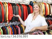 Купить «Seller in leather clothes shop», фото № 34016991, снято 5 сентября 2018 г. (c) Яков Филимонов / Фотобанк Лори