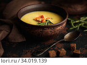 Купить «Fish cream soup with Salmon, cheese, Potatoes and herbs in white Soup Bowls.», фото № 34019139, снято 4 марта 2019 г. (c) Nataliia Zhekova / Фотобанк Лори
