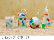 Купить «Handmade candles in the shape of a pyramid, cube, cylinder and sphere», фото № 34019459, снято 1 февраля 2017 г. (c) Nataliia Zhekova / Фотобанк Лори