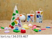 Купить «Handmade candles in the shape of a pyramid, cube, cylinder and sphere», фото № 34019467, снято 1 февраля 2017 г. (c) Nataliia Zhekova / Фотобанк Лори