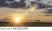 Купить «Flat hill meadow timelapse at the summer sunrise time. Wild nature and rural field. Sun rays, trees, green grass movement. Motorised dolly slider», видеоролик № 34020059, снято 1 апреля 2020 г. (c) Александр Маркин / Фотобанк Лори