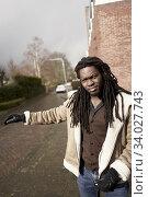 Poised man at street. Leeuwarden, Friesland, Netherlands, Europe. Стоковое фото, фотограф Egerland Productions / age Fotostock / Фотобанк Лори