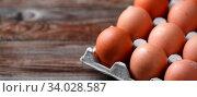 Купить «Brown eggs on a rustic wooden table», фото № 34028587, снято 12 июля 2020 г. (c) easy Fotostock / Фотобанк Лори