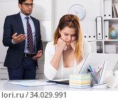 Stressed businesswoman with dissatisfied colleague. Стоковое фото, фотограф Яков Филимонов / Фотобанк Лори