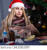Unhealthy female is sitting in a plaid with medications in the New Year night. Стоковое фото, фотограф Яков Филимонов / Фотобанк Лори